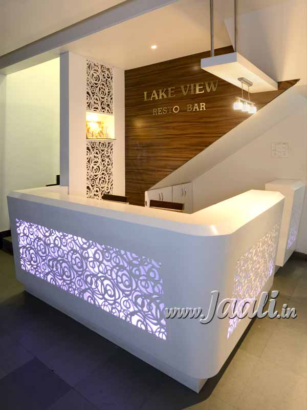 099 12mm Corian Jaali as Partition & in Reception Counter Face